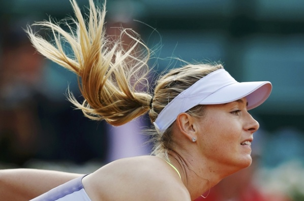Sharapova starts her title defense with victory